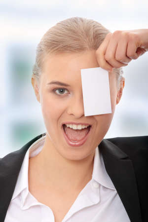 Young caucasian businesswoman with business card photo