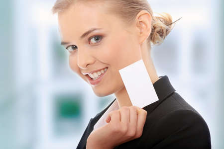 Beautiful businesswoman with businesscard, isolated on white background photo