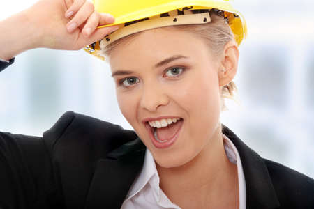 Portrait of confident female worker in helmet isolated on white background photo