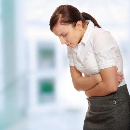 Business-Frau mit Magen-Probleme