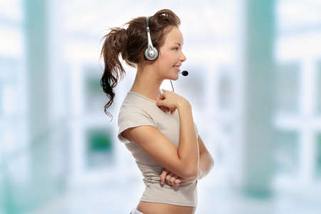 Beautiful Call Center Woman Wearing A Telephone Headset, isolated on white background  photo
