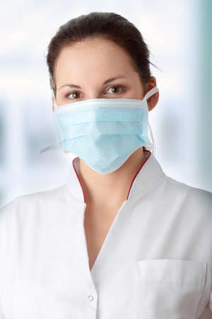 h1n1 vaccinations: Young caucasian nurse in mask