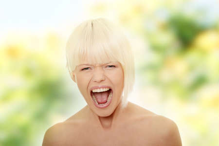 Portrait of gorgeous blonde female screaming photo