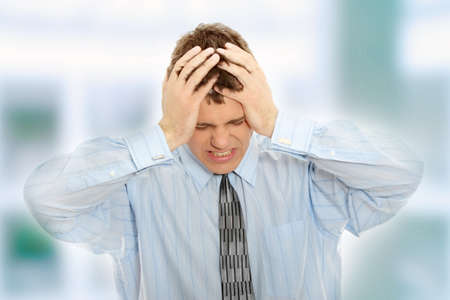 Businessman with a big headache (with copy space)  photo