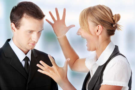 business disagreement: Work Colleagues arguing in office