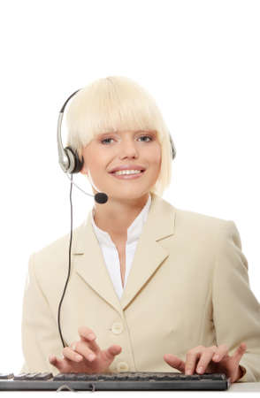 Call center woman with headset. Beautiful smiling caucasian woman isolated on white background.  photo