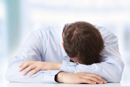 depression man: Businessman in depression with hand on forehead Stock Photo