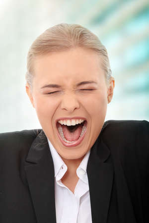 Young business woman shouting Stock Photo - 8048383