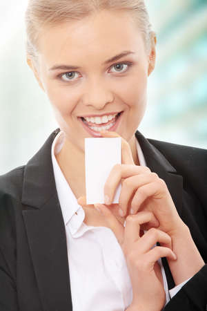 Beautiful businesswoman with business card photo