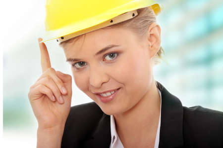 Portrait of confident female worker in helmet photo