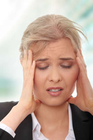 Young business woman with headache Stock Photo - 8048386