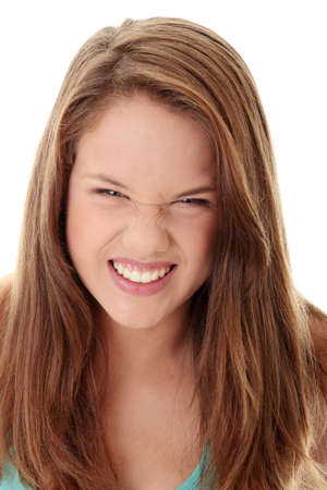 angry teenager: Close Up Shot of a Beautiful Angry Teenager, isolated on white background  Stock Photo