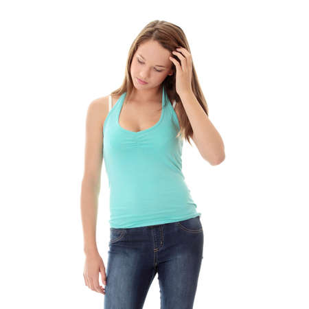 troubled teen: Teenage beautiful woman with depression isolated on white