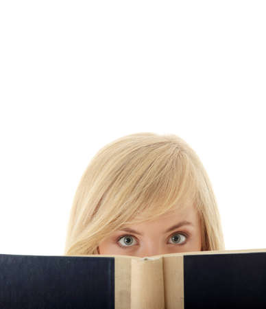 looking over: Girl reading a book, isolated on white background