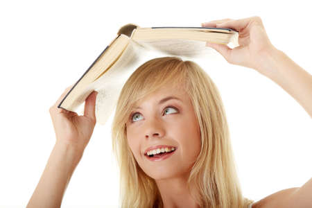 Teen girl with book over her head, isolated on white Stock Photo - 8048244