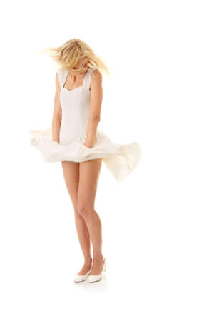 Blond sexy woman in white skirt blowed by wind, isolated on white background Stock Photo - 8044100