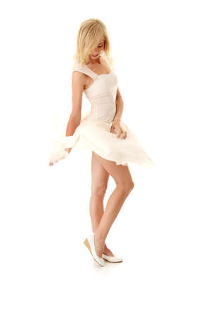 Blond sexy woman in white skirt blowed by wind, isolated on white background Stock Photo - 8048046