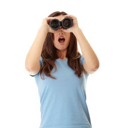 Teen girl with binocular - shocked, isolated on white  photo