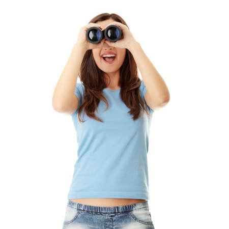 Teen girl with binocular isolated on white  photo