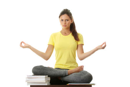 Happy student gir meditating, isolated on white Stock Photo - 8048103