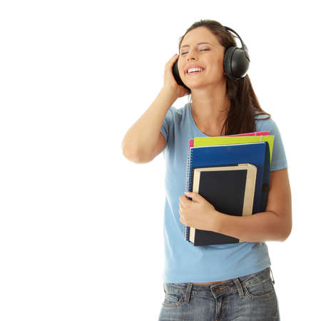 Happy student girl listening to the music, isolated on white Stock Photo - 8048416