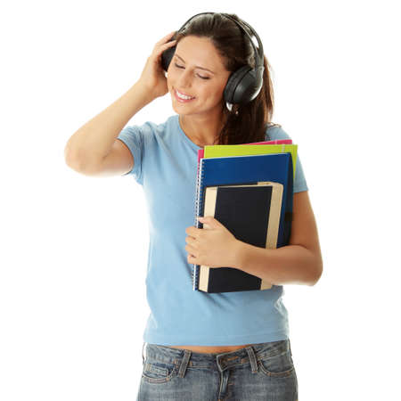 Happy student girl listening to the music, isolated on white Stock Photo - 8048428