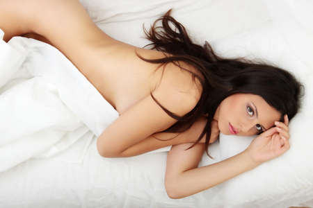 Closeup portrait of a cute young woman sleeping on the bed Stock Photo - 8048328