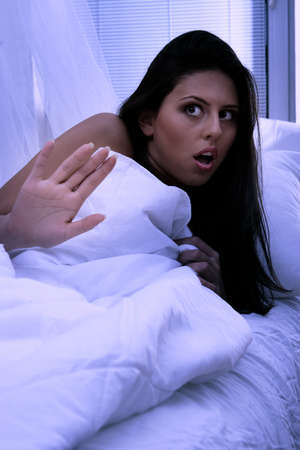Young woman in bed abused at night Stock Photo - 8048333