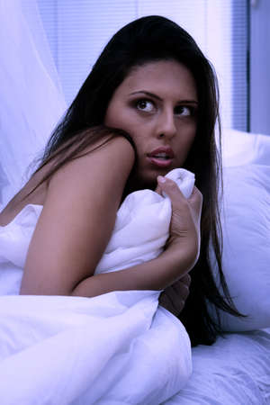 Young woman in bed abused at night Stock Photo - 8048334