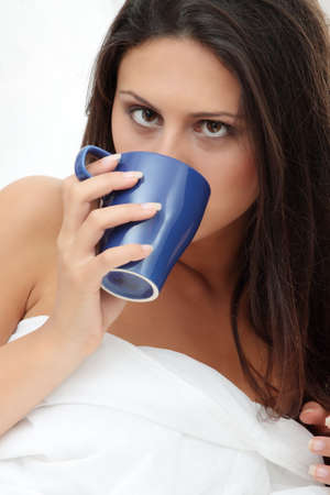 Beautiful lady is drinking coffee at bed Stock Photo - 8048413