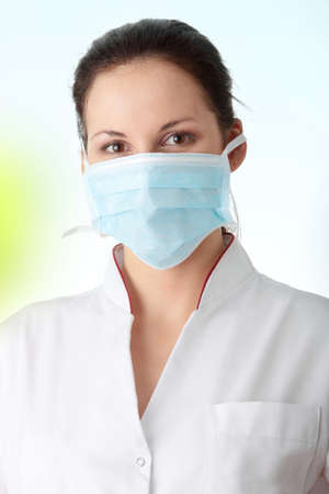 swine flu vaccination: Young nurse or doctor in mask Stock Photo