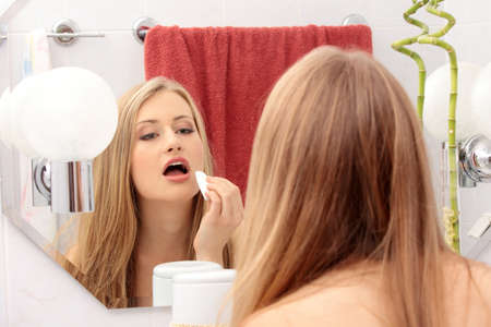 Young woman cleaning her face in the bathroom Stock Photo - 8719982