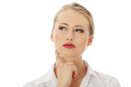Thoughtful business woman looking left isolated over a white background  photo
