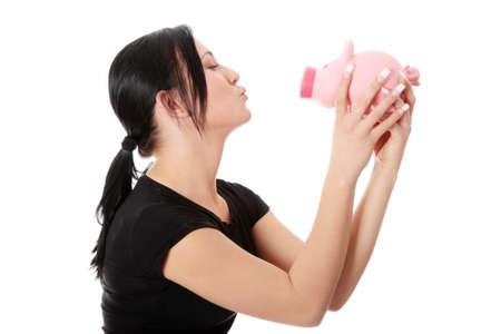 coinbank: Concepto de ahorros - una mujer con una hucha - aislado en blanco  Foto de archivo