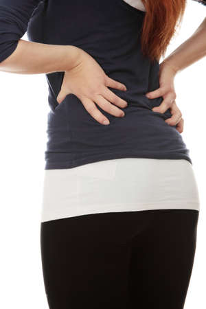 Young woman with pain in her back. Isolated photo