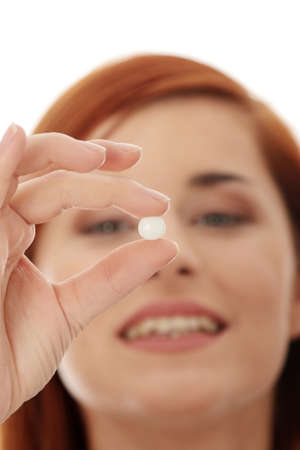 pills in hand: Joven feliz con la p�ldora, aislado  Foto de archivo