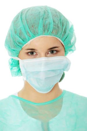 Close-up portrait of serious nurse or doctor in white mask  photo