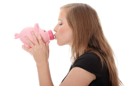 Young teen woman kissing a piggy bank, isolated on white Stock Photo - 8829609