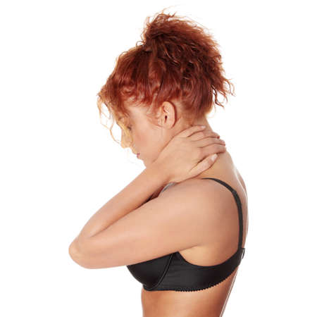 Woman massaging pain in her neck, isolated on white Stock Photo - 8830336