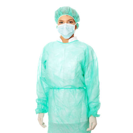 Portrait of serious nurse or doctor in surgical mask photo