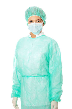 surgical cap: Close-up portrait of serious nurse or doctor in surgical mask Stock Photo