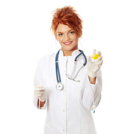 Portrait of a nurse making a drip, isolated on white  photo
