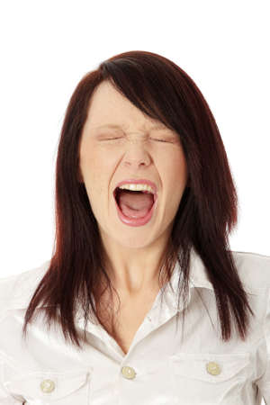 Scared young caucasian woman screaming, isolated on white  photo