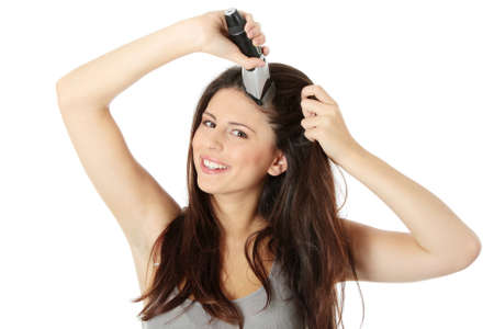 Young woman cutting her long hairs with hair clipper, isolated on white Stock Photo - 8827747