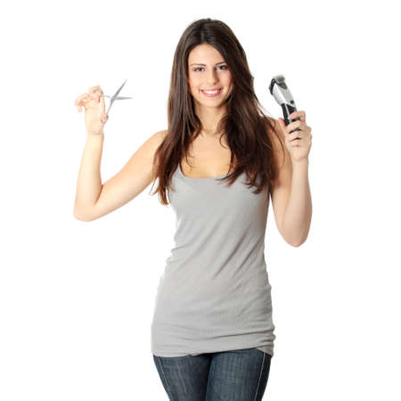 hairdresser scissors: Young beautiful female hairdresser holding scissors and hair clipper, isolated on white