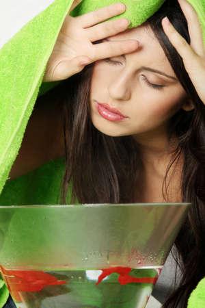 Young beautiful woman making inhalation at home.  Natural medicine concept photo