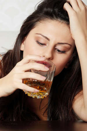liquor girl: Yound beautiful woman in depression, drinking alcohol
