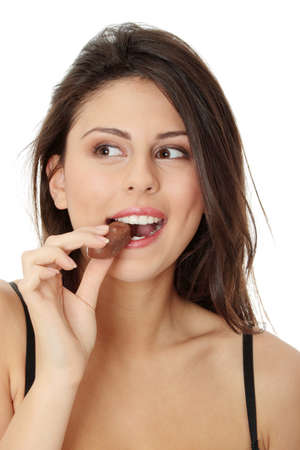 eating chocolate: Young beautiful woman eating bar, isolated on white