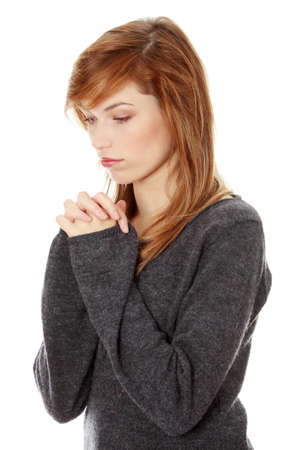 beliefs: Closeup portrait of a young caucasian woman praying isolated on white background Stock Photo