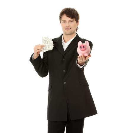 Young business holding piggy bank and dollars , isolated on white photo